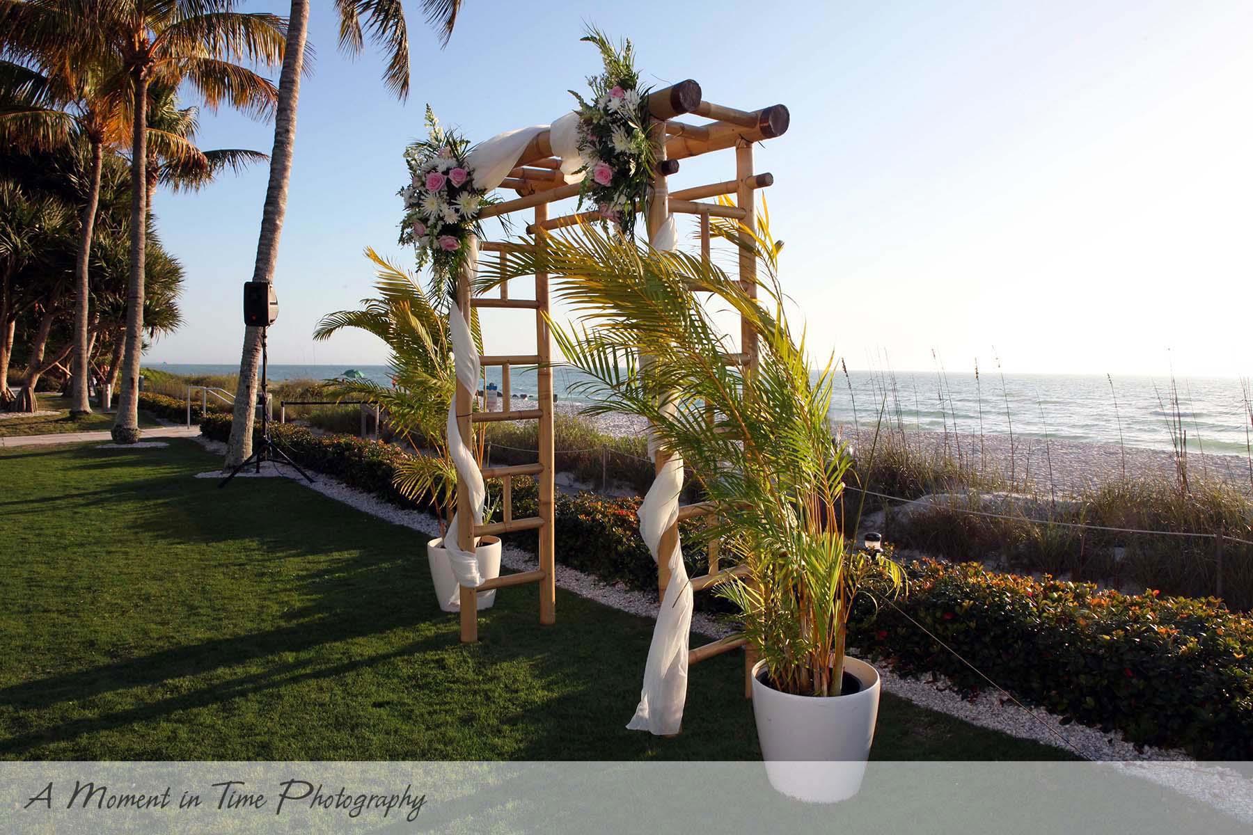 Florist: Driftwood Garden Center DJ: Naples DJ Cake Designer: Ellau0027s Cakes  Venue: The Naples Beach Hotel U0026 Golf Club
